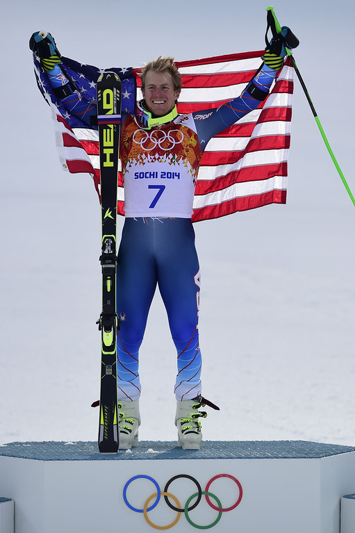 . Gold medallist US skier Ted Ligety stands on the podium during the Men\'s Alpine Skiing Giant Slalom Flower Ceremony at the Rosa Khutor Alpine Center during the Sochi Winter Olympics on February 19, 2014.  AFP PHOTO / OLIVIER MORIN/AFP/Getty Images