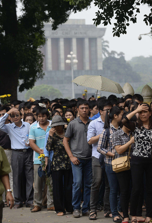 . Thousands line up in front of late president Ho Chi Minh\'s mausoleum (background) along a street leading to the late General Vo Nguyen Giap\'s residence to pay their final respects in Hanoi on October 10, 2013. The death of Vietnam\'s last great independence leader has sparked a battle over his legacy, with the regime seeking a girm grip on his image as communist hero, and brushing aside his criticism of the party in later life. HOANG DINH NAM/AFP/Getty Images