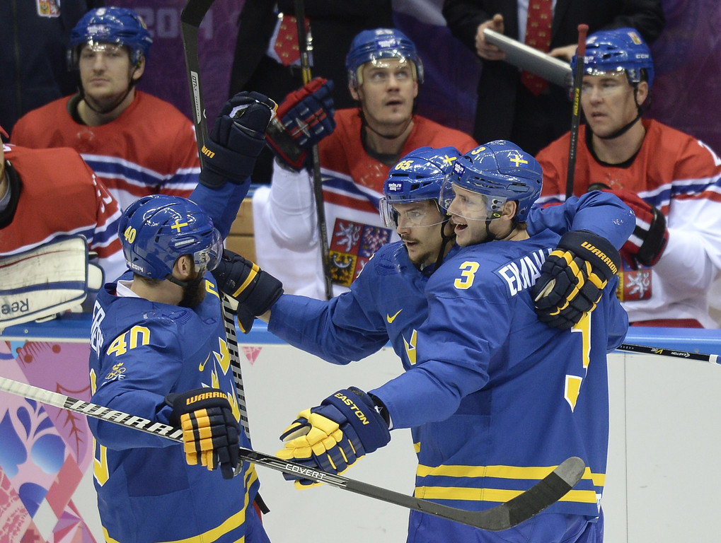 . Sweden\'s Erik Karlsson, Sweden\'s Oliver Ekman Larsson and Sweden\'s Henrik Zetterberg celebrate after scoring during the Men\'s Ice Hockey Group B match Czech Republic vs Sweden at the Bolshoy Ice Dome on February 12, 2014 at the Sochi Winter Olympics in Sochi.   ALEXANDER NEMENOV/AFP/Getty Images