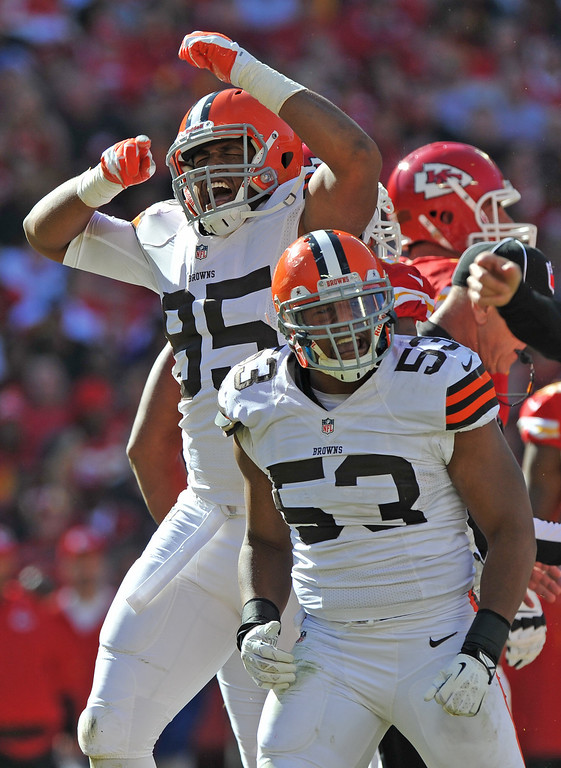. Defenders Graig Robertson #53 and Armonty Bryant #95 of the Cleveland Browns celebrate after sacking quarterback Alex Smith of the Kansas City Chiefs during the second half on October 27, 2013 at Arrowhead Stadium in Kansas City, Missouri.  Kansas City won 23-17. (Photo by Peter Aiken/Getty Images)