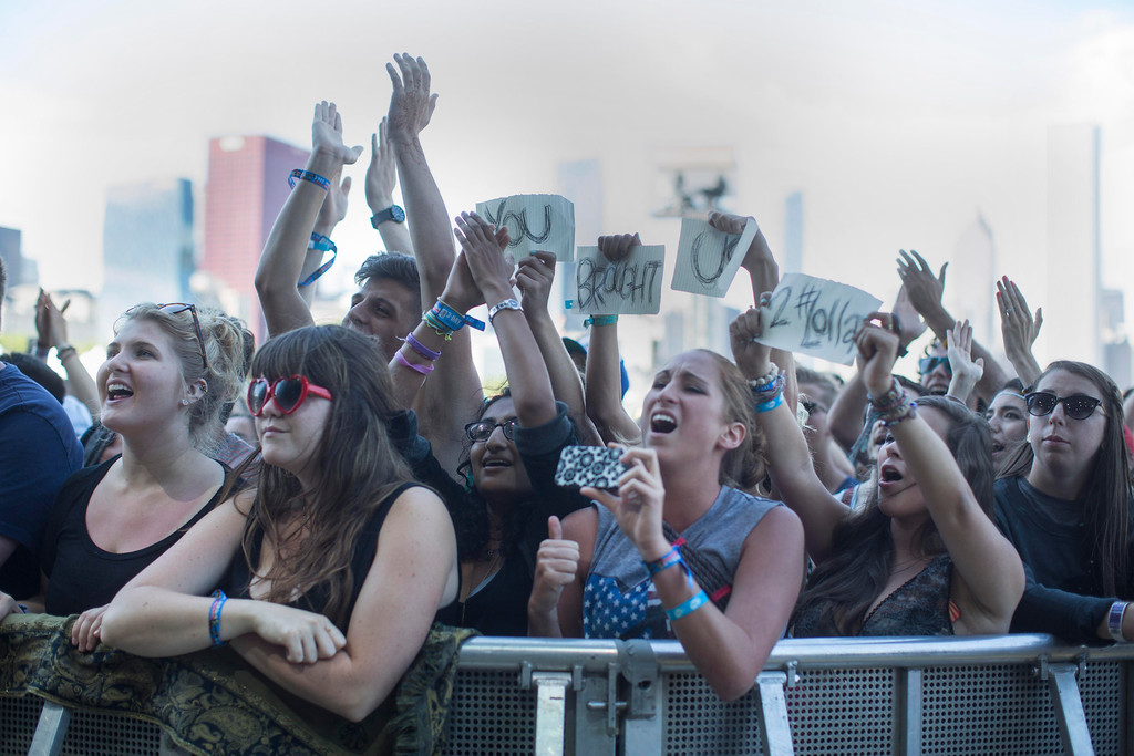 ". Ben Howard fans hold up a sign that says ""You Brought Us To Lollapalooza\"" during his performance at the Red Bull Stage at the Lollapalooza Festival in Chicago, Saturday, Aug. 3, 2013. The more than two-decade-old festival opened Friday in Chicago\'s lakefront Grant Park. (AP Photo/Scott Eisen)"
