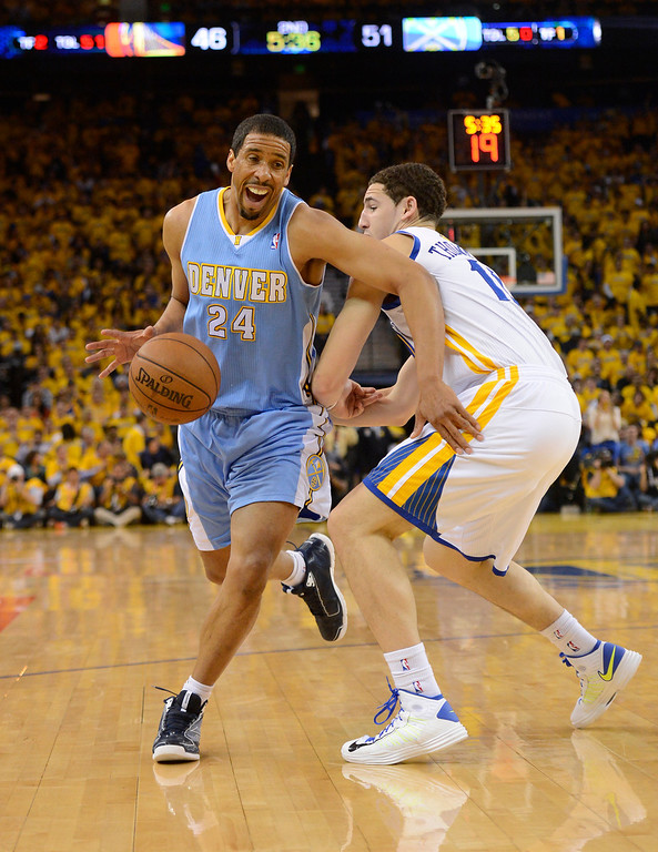 . OAKLAND, CA. - APRIL 26: Andre Miller (24) of the Denver Nuggets drives on Klay Thompson (11) of the Golden State Warriors during the second quarter in game 3 of the first round of the NBA Playoffs April 26, 2013 at Oracle Arena.  (Photo By John Leyba/The Denver Post)