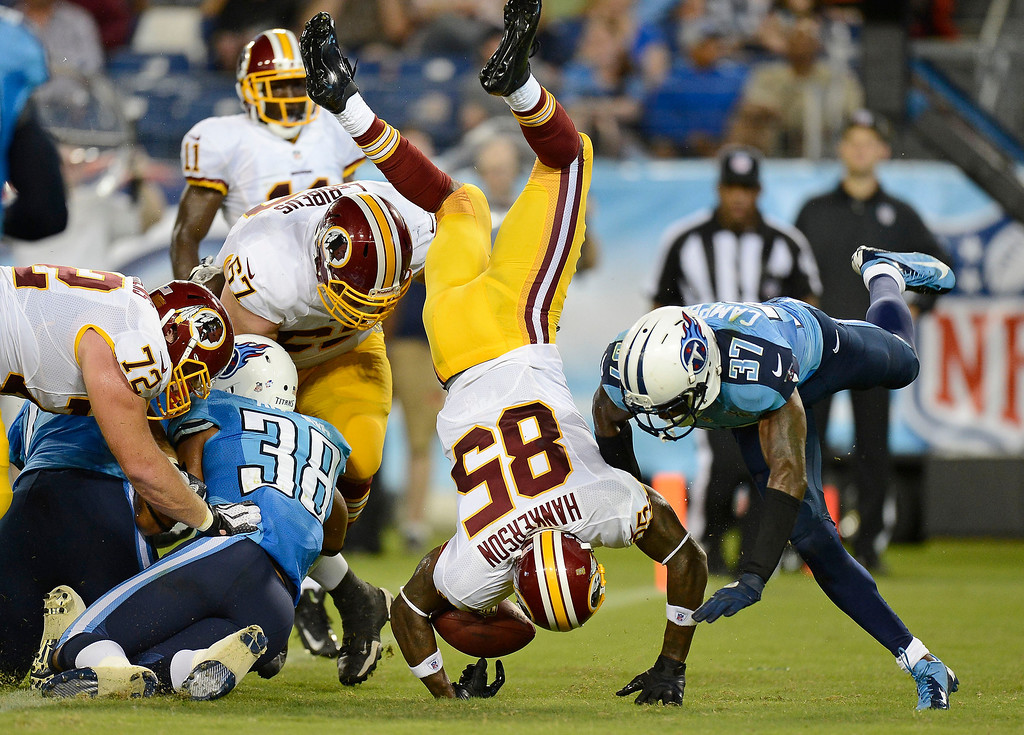 . Washington Redskins wide receiver Leonard Hankerson (85) flips into the end zone as he scores a touchdown on an 8-yard pass play against the Tennessee Titans in the second quarter of a preseason NFL football game on Thursday, Aug. 8, 2013, in Nashville, Tenn. Titans\' Al Afalava (38) and Tommie Campbell (37) defend. (AP Photo/Mark Zaleski)