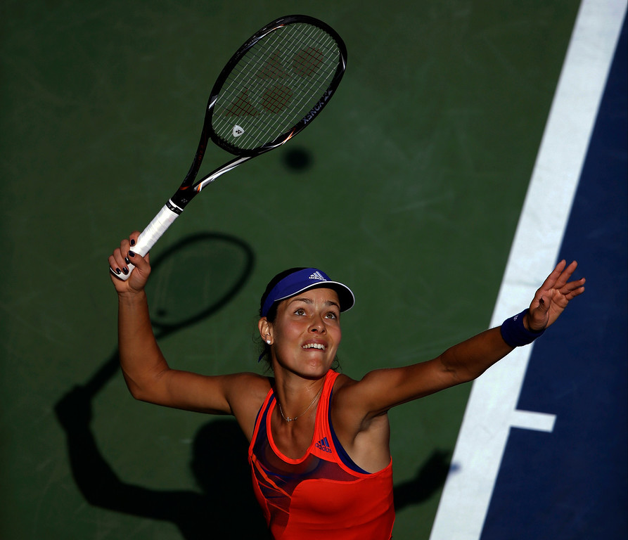 . Ana Ivanovic, of Serbia, serves to Alexandra Dulgheru, of Romania, during the second round of the 2013 U.S. Open tennis tournament, Thursday, Aug. 29, 2013, in New York. (AP Photo/Mike Groll)