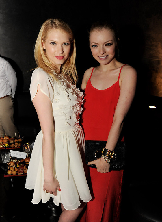 """. Actresses Claudia Lee (L) and Francesca Eastwood pose at the after party for the premiere of Open Road Films\' \""""The Host\"""" at Lure on March 19, 2013 in Los Angeles, California.  (Photo by Kevin Winter/Getty Images)"""