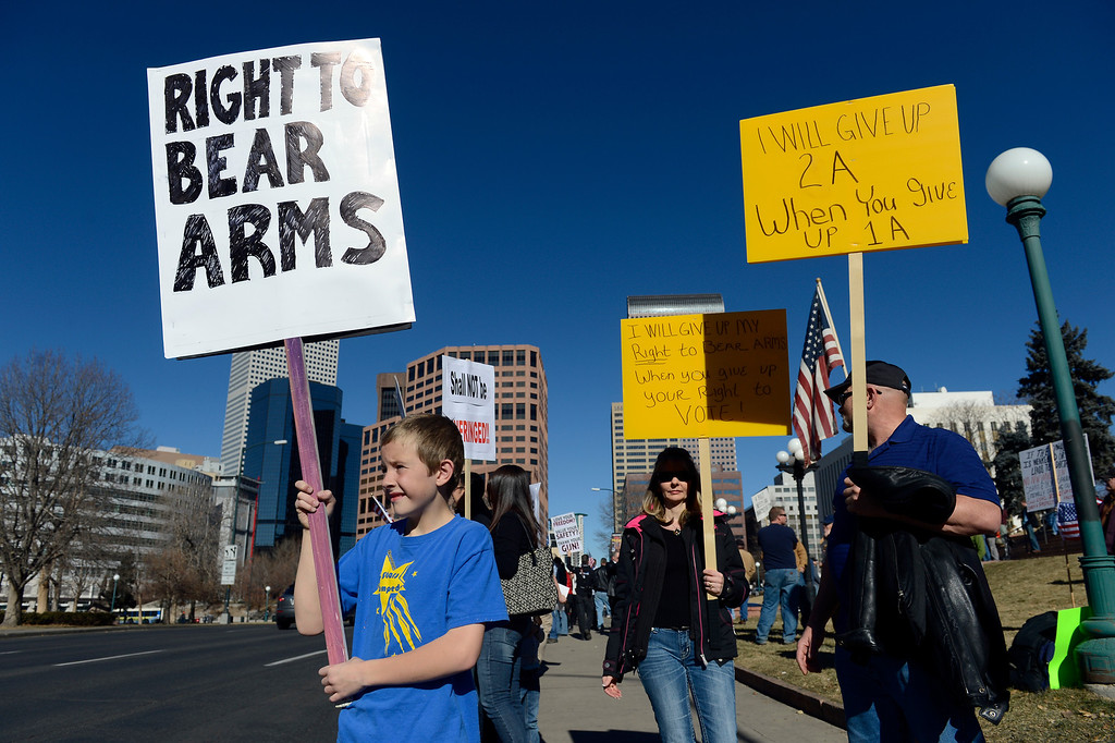 . DENVER, CO. - JANUARY  19: Lleyton Farrell, 9-years-old, left, shows his support (with his father nearby, not pictured) along with others along Lincoln Ave. in front of the Colorado State Capitol Saturday afternoon, January 19th, 2013, Nearly 1000 Pro gun supporters rallied at the Colorado State Capitol Saturday that included many speeches and songs. (Photo By Andy Cross / The Denver Post)