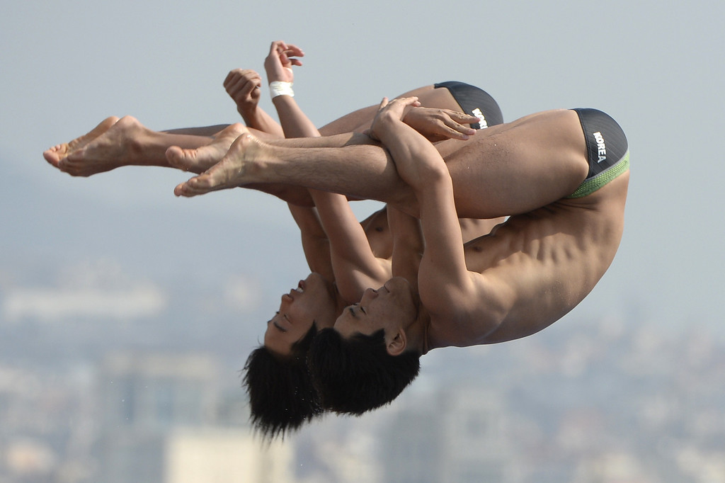 . South Korea\'s Woo Haram and Kim Yeongnam compete in the men\'s 10-metre synchro platform preliminary diving event in the FINA World Championships at the Piscina Municipal de Montjuic in Barcelona on July 21, 2013.   LLUIS GENE/AFP/Getty Images