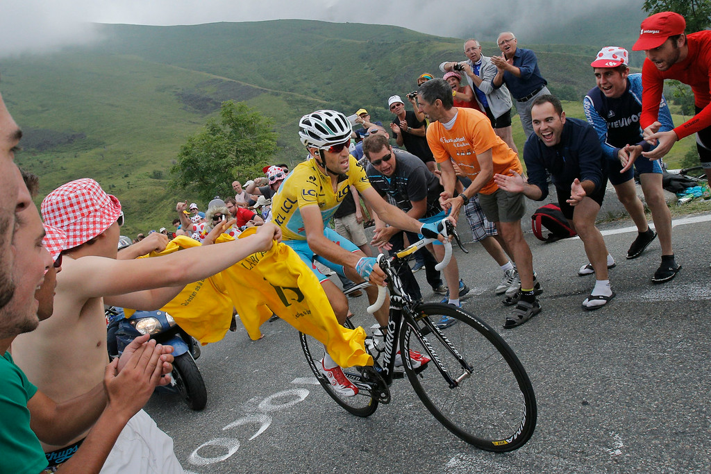 . Stage winner Vincenzo Nibali of Italy, wearing the overall leader\'s yellow jersey, climbs towards Hautacam after breaking away from his rivals during the eighteenth stage of the Tour de France cycling race over 145.5 kilometers (90.4 miles) with start in Pau and finish in Hautacam, Pyrenees region, France, Thursday, July 24, 2014. (AP Photo/Christophe Ena)