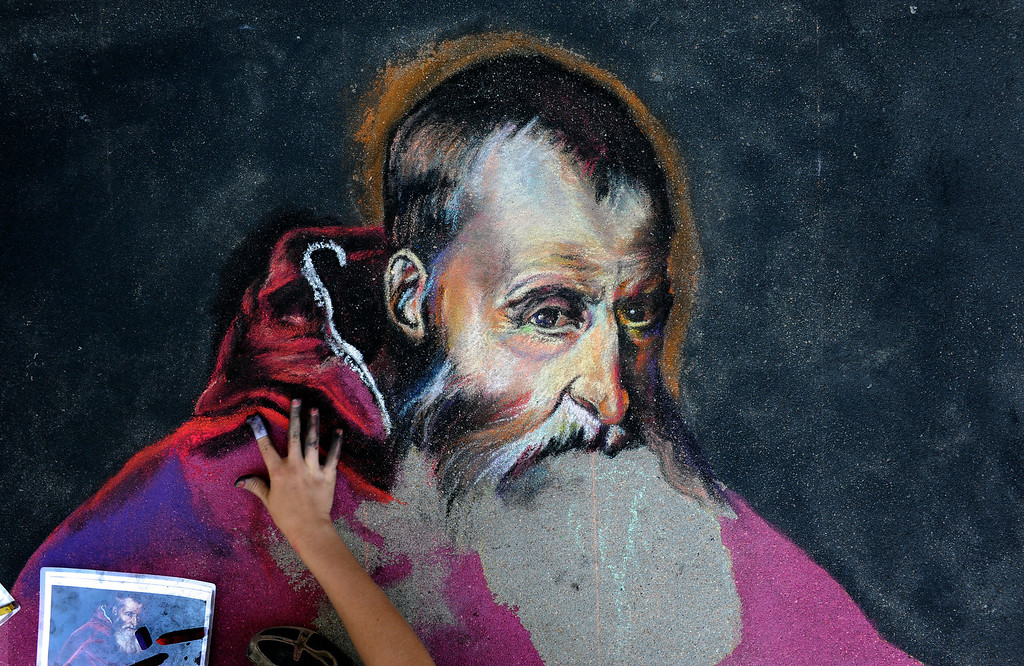 . Grace Hollenbeck works on a chalk drawing during the 9th annual Festival Italiano at Belmar in Lakewood, CO, Saturday September 08, 2012. The portrait of Pope Paul III was originally painted by Titian. The free festival, celebrating Italian culture, continues through Sunday. Attractions include live music, fashion shows, wine tastings, grape stomping for kids, a bocce tournament, chef demonstrations and traditional Italian flag throwers. A portion of the proceeds benefit Project Angel Heart. Craig F. Walker, The Denver Post
