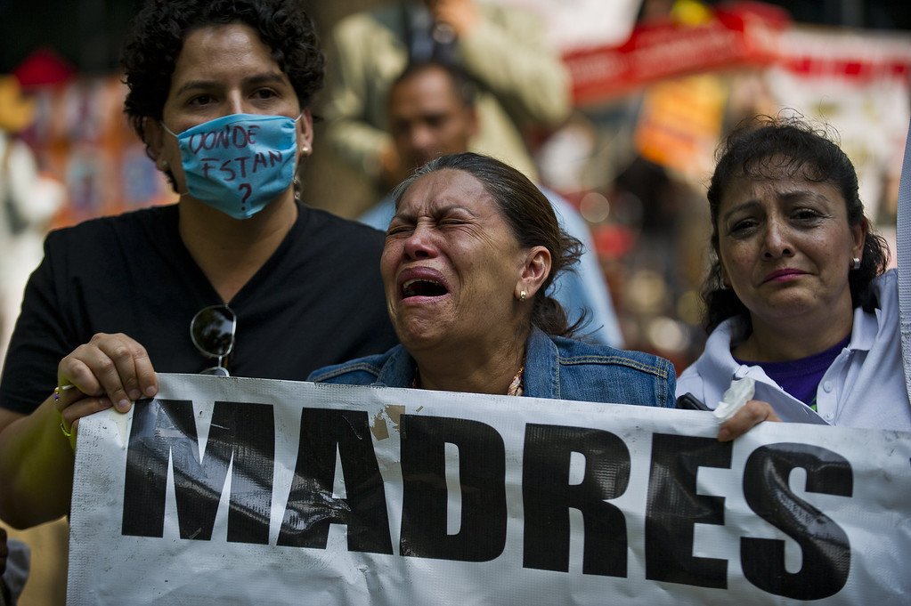 . A mother cries during a protest in Mexico City on May 10, 2013. A group of mothers and relatives of children missing due to the drug war in the country, demand to the Government the investigation of the crimes. Ronaldo Schemidt/AFP/Getty Images