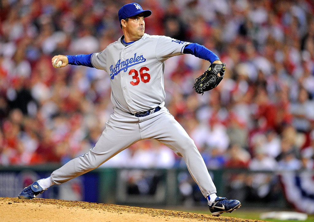 . Greg Maddux #36 of the Los Angeles Dodgers throws a pitch against the Philadelphia Phillies in Game One of the National League Championship Series during the 2008 MLB playoffs on October 9, 2008 at Citizens Bank Ballpark in Philadelphia, Pennsylvania. The Phillies won 3-2.  (Photo by Jeff Zelevansky/Getty Images)