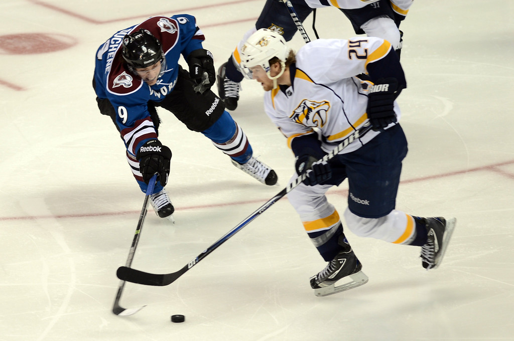 . Matt Duchene of Colorado Avalanche (#9), left, is defending Matt Halischuk of Nashville Predators (#24) in the 2nd period of the game at Pepsi Center. Denver, Colorado. March 30, 2013. (Photo By Hyoung Chang/The Denver Post)