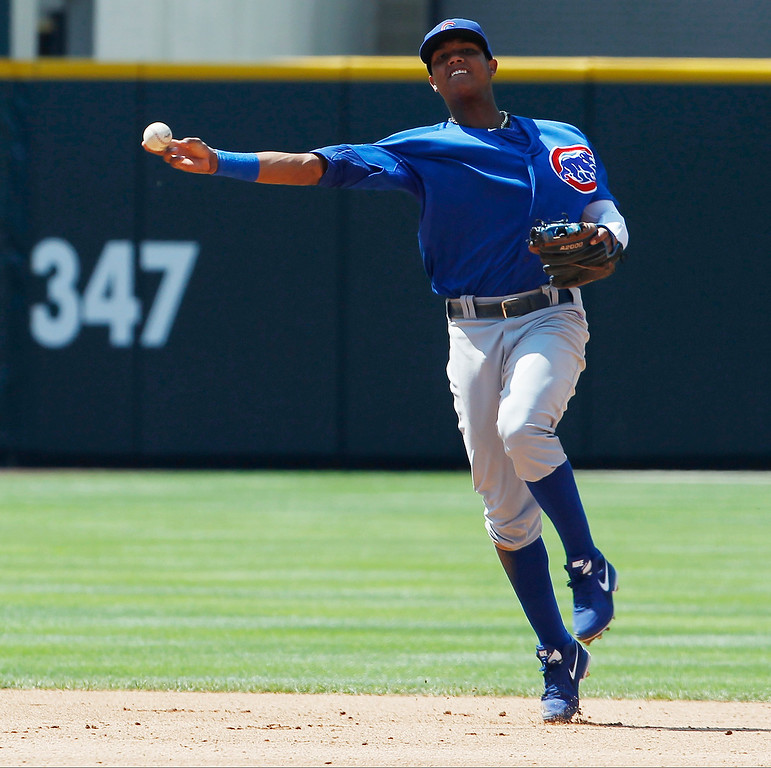 . Chicago Cubs shortstop Starlin Castro throws after fielding an infield single off the bat of Colorado Rockies\' Carlos Gonzalez in the fourth inning of a baseball game in Denver, Sunday, July 21, 2013. (AP Photo/David Zalubowski)