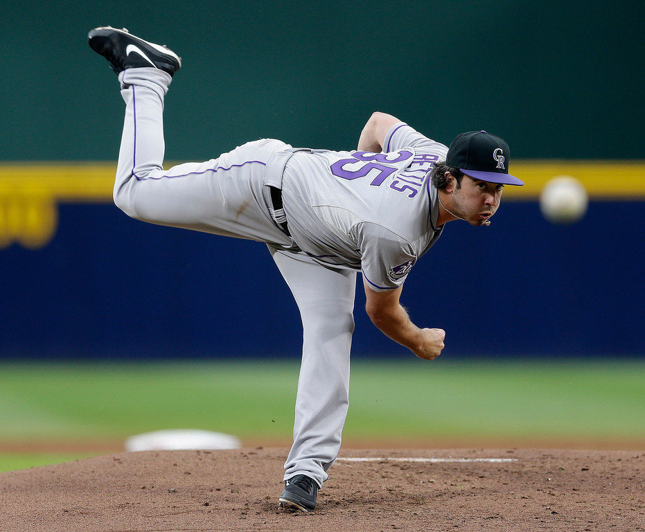 . Colorado Rockies pitcher Chad Bettis delivers in the first inning of a baseball game against the Atlanta Braves  in Atlanta,  Thursday, Aug. 1, 2013. Bettis was making his major league debut. (AP Photo/John Bazemore)