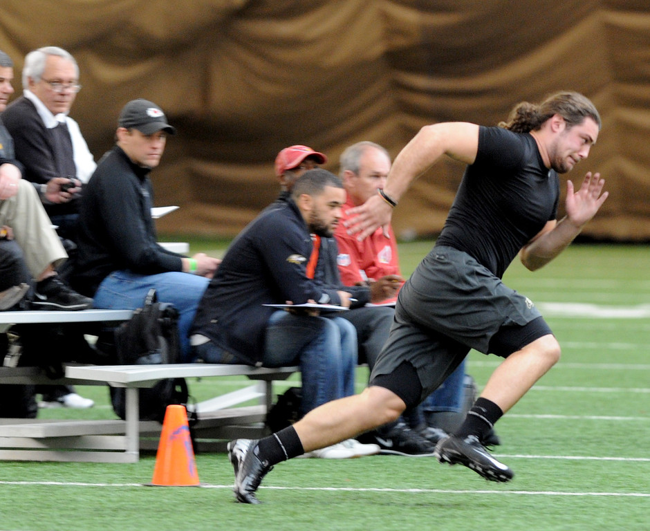 . Jon Major runs in one of the agility drills for NFL scouts on Wednesday. Scouts from around the NFL  tested and watched University of Colorado football players during CU pro timing day on Wednesday. (Cliff Grassmick/Boulder Daily Camera)