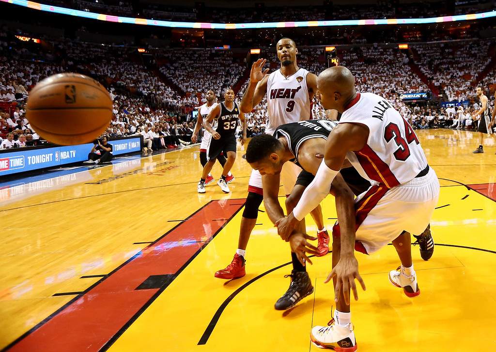 . MIAMI, FL - JUNE 10:  Tim Duncan #21 of the San Antonio Spurs and Ray Allen #34 of the Miami Heat battle for a rebound during Game Three of the 2014 NBA Finals at American Airlines Arena on June 10, 2014 in Miami, Florida.  (Photo by Andy Lyons/Getty Images)