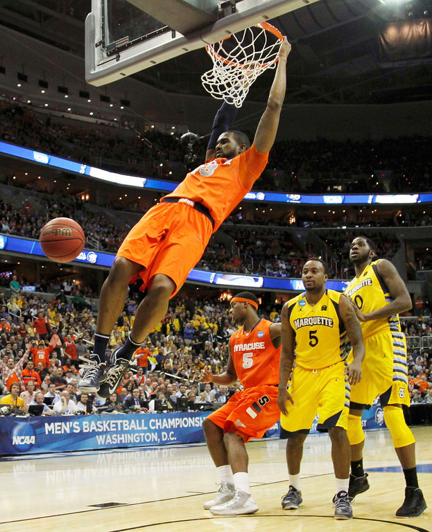 . Syracuse Orange forward James Southerland dunks against the Marquette Golden Eagles during the second half in their East Regional NCAA men\'s basketball game in Washington, March 30, 2013. REUTERS/Jason Reed