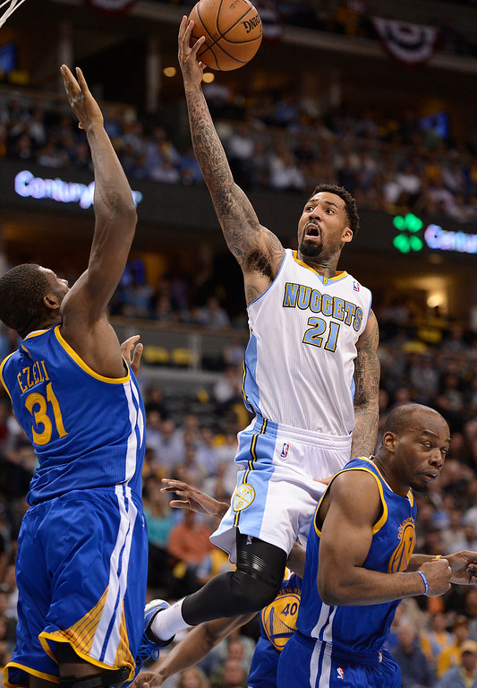 . Denver Nuggets shooting guard Wilson Chandler (21) goes up for a shot against Golden State Warriors center Festus Ezeli (31) in the second quarter. The Denver Nuggets took on the Golden State Warriors in Game 5 of the Western Conference First Round Series at the Pepsi Center in Denver, Colo. on April 30, 2013. (Photo by John Leyba/The Denver Post)