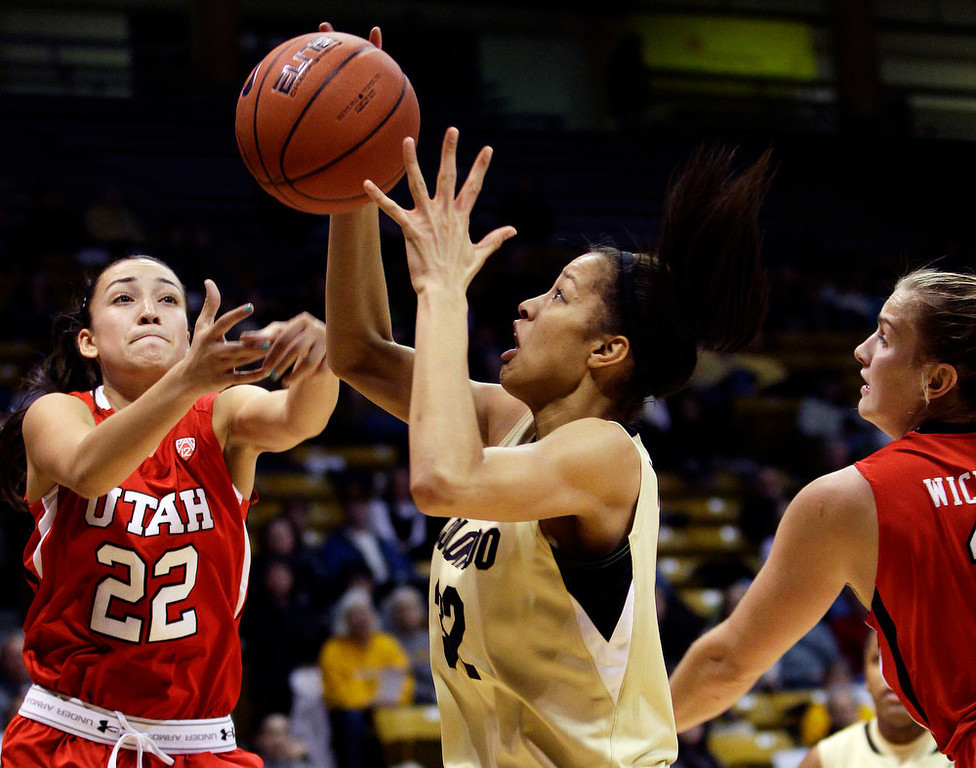 . Colorado\'s Arielle Roberson, center, and Utah\'s Danielle Rodriguez struggle for a rebound during the first half of their NCAA college basketball game, Tuesday, Jan. 8, 2013, in Boulder, Colo. (AP Photo/Brennan Linsley)
