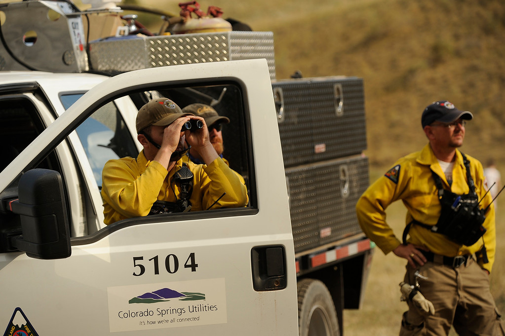 . FIrefighters from Colorado Springs Utilities watch the approaching fire. The Waldo Canyon fire exploded on June 26th, 2012  The Waldo Canyon fire continued to burn northwest of Manitou Springs, Colorado.  Helen H. Richardson, The Denver Post