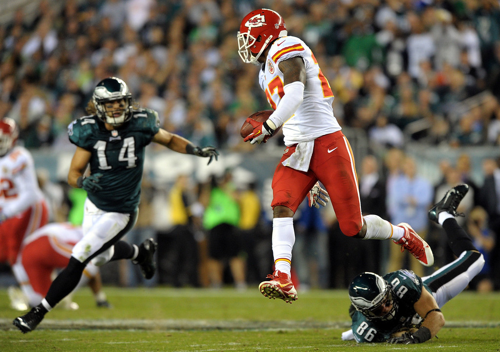 . Kansas City Chiefs cornerback Sean Smith (27) leaps in the air after he intercepted a pass as Philadelphia Eagles wide receiver Riley Cooper (14) and tight end Zach Ertz defend during an NFL football game Thursday, Sept. 19, 2013, in Philadelphia. (AP Photo/The Express-Times, Matt Smith)