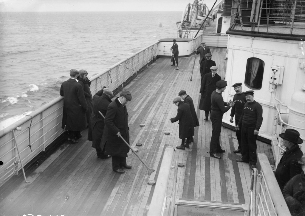 . Saloon passengers enjoy a game of shuffleboard on the deck of the Cunard liner Lusitania. Circa 1912.  (Photo by Topical Press Agency/Getty Images)