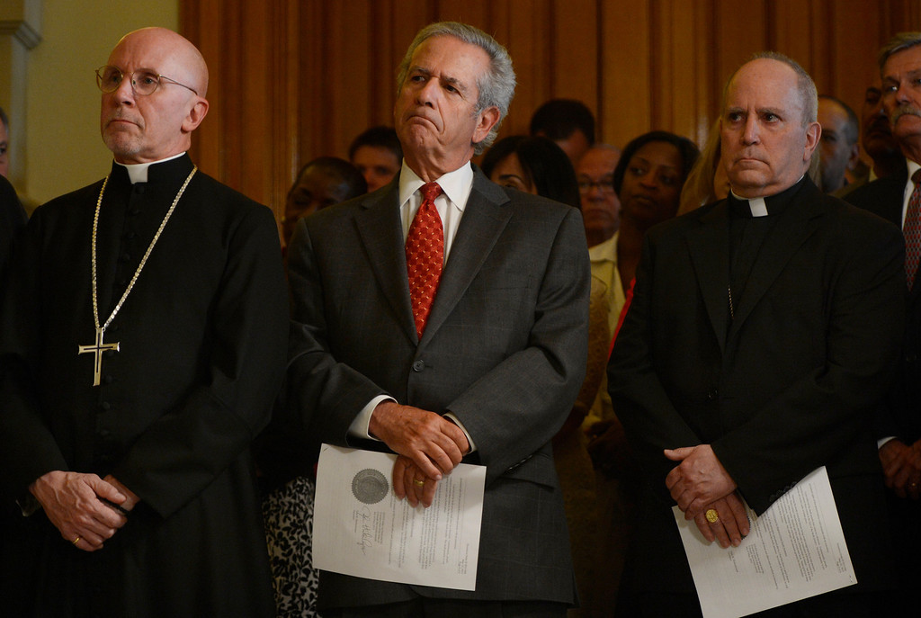 """. DENVER, CO. - MAY 21: (l-r) The Very Rev. Peter Eaton, Dean of Saint John\'s Episcopal Cathedral, Rabbi Steven Foster and Roman Catholic Archbishop Samuel J. Aquila listen to comments from Gov. John Hickenlooper during a press conference at the capitol in Denver, CO May 21, 2013. Hickenlooper issued an executive order granting convicted killer Nathan Dunlap a \""""temporary reprieve\"""" from an execution that had been just three months away. (Photo By Craig F. Walker/The Denver Post)"""