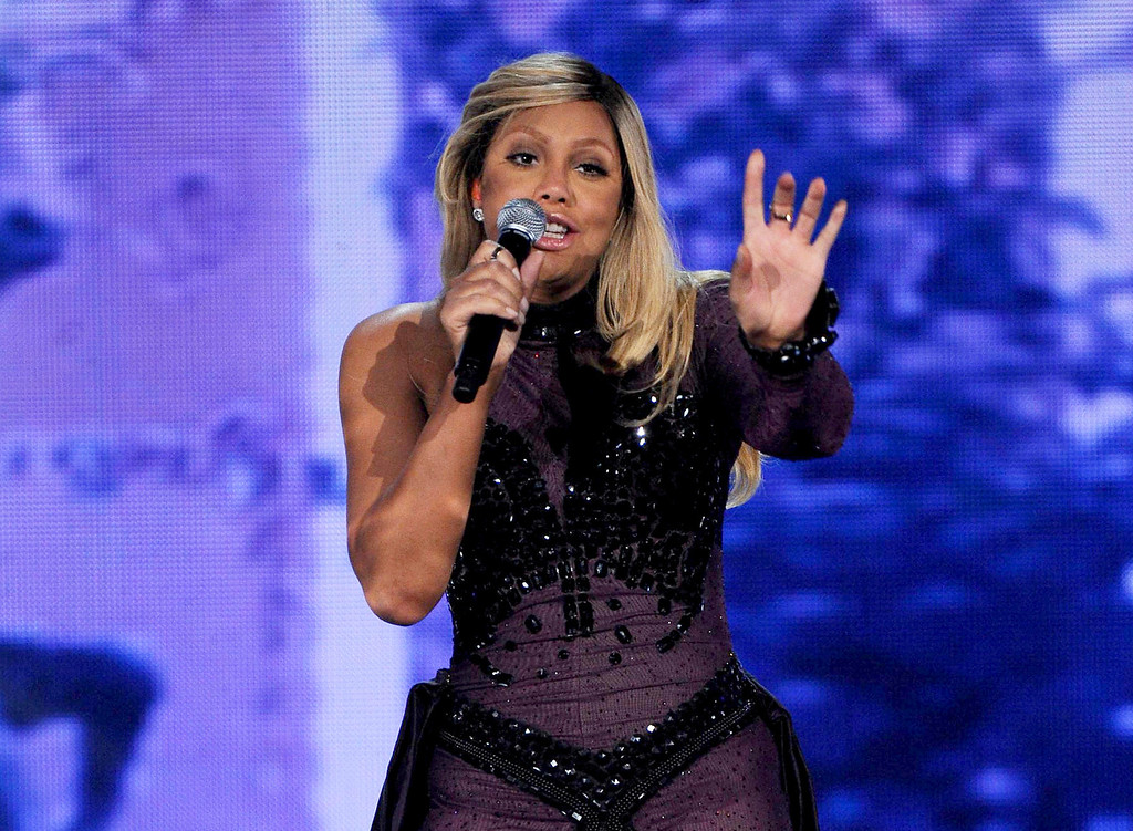 ". FILE - This Nov. 8, 2013 file photo shows Tamar Braxton performing at the 2013 Soul Train Awards at the Orleans Arena in Las Vegas. Braxton is nominated for three honors at Sunday\'s Grammy Awards, including best urban contemporary album for her first album in 13 years, ""Love and War.\"" The title track is also nominated for best R&B song and R&B performance. (Photo by Frank Micelotta/Invision/AP, File)"