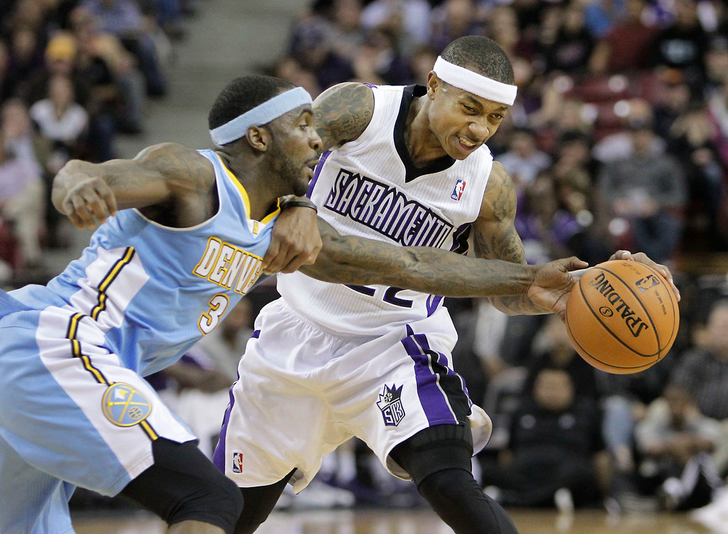 . Denver Nuggets guard Ty Lawson, tries to steal the ball from Sacramento Kings guard Isaiah Thomas during the third quarter of an NBA basketball game in Sacramento, Calif., Tuesday, March 5, 2013.  The Nuggets won 120-113.(AP Photo/Rich Pedroncelli)