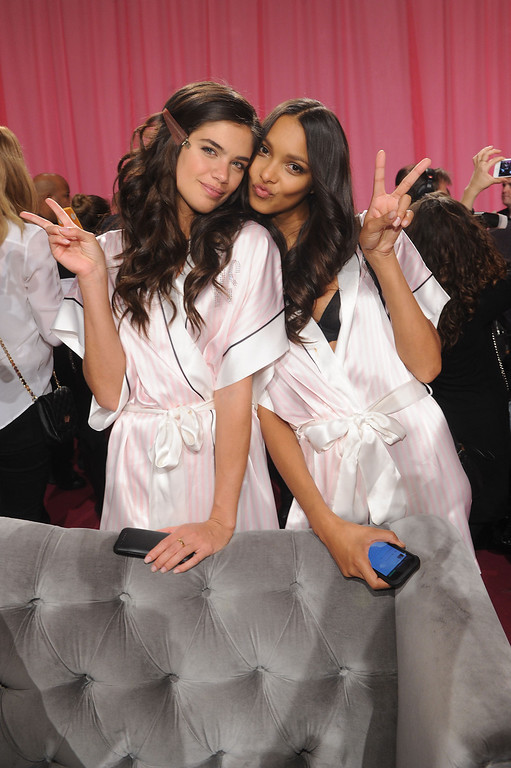 . Models Sara Sampaio and Lais Ribeiro prepare at the 2013 Victoria\'s Secret Fashion Show hair and makeup room at Lexington Avenue Armory on November 13, 2013 in New York City.  (Photo by Jamie McCarthy/Getty Images)