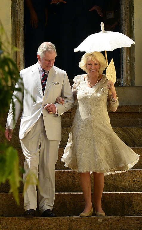 . Britain\'s Prince Charles and his wife Camilla, the Duchess of Cornwall, walk out of the Mattancherry Palace, where historical artifacts are showcased, in Kochi, India, Thursday, Nov. 14, 2013.   (AP Photo)