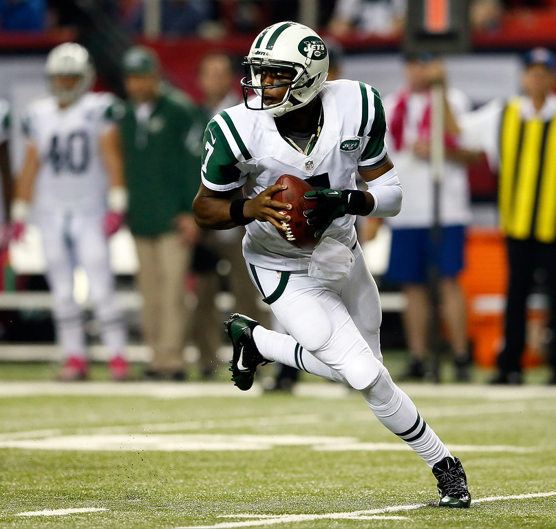 . Quarterback Geno Smith #7 of the New York Jets drops back against the Atlanta Falcons during their game at the Georgia Dome on October 7, 2013 in Atlanta, Georgia.  (Photo by Kevin C. Cox/Getty Images)