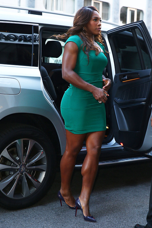 """. 2013 US Open Champion Serena Williams of the United States enters from the street to her appearace on the \""""CBS This Morning\"""" show on her New York City Trophy Tour on September 9, 2013 in New York City.  (Photo by Joe Scarnici/Getty Images)"""