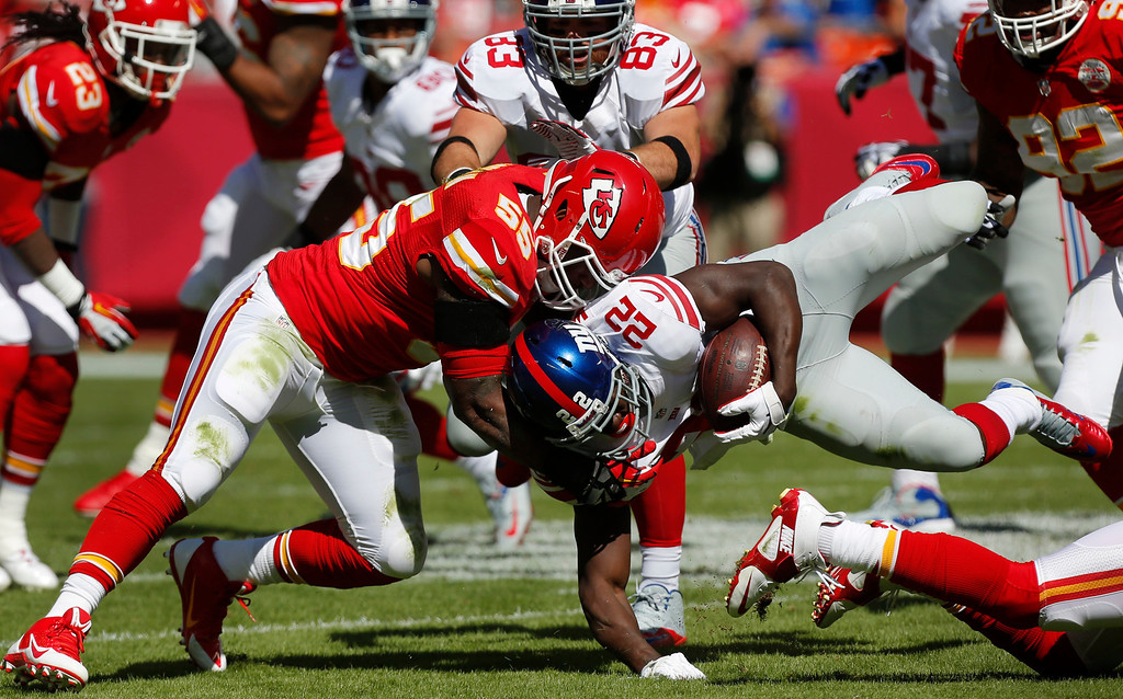 . New York Giants running back David Wilson (22) is tackled by Kansas City Chiefs inside linebacker Akeem Jordan (55) during the first half of an NFL football game at Arrowhead Stadium in Kansas City, Mo., Sunday, Sept. 29, 2013. (AP Photo/Ed Zurga)