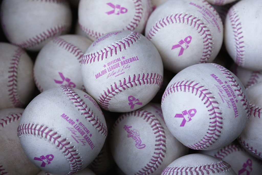 . Official Major League Baseball balls with pink stitching and lettering to observe Mother\'s Day are seen during the game between the Colorado Rockies and the Cincinnati Reds at Great American Ball Park on May 11, 2014 in Cincinnati, Ohio. (Photo by Joe Robbins/Getty Images)