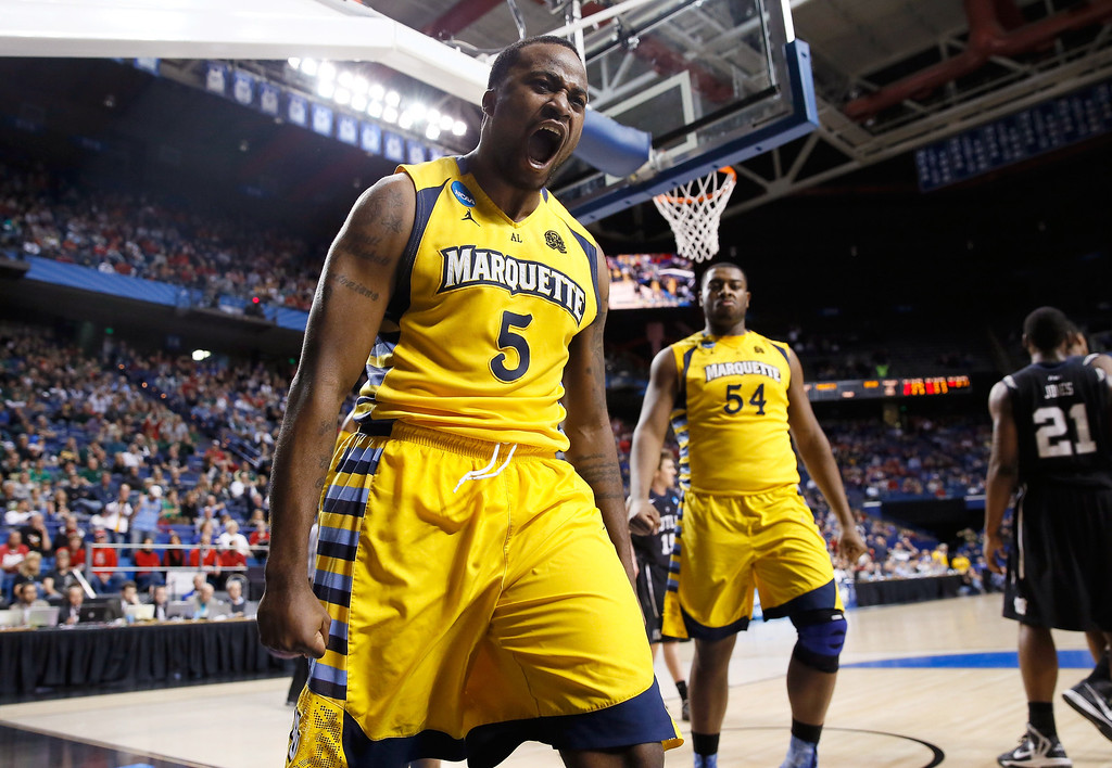 . LEXINGTON, KY - MARCH 23: Junior Cadougan #5 of the Marquette Golden Eagles reacts after scoring a basket and being fouled against the Butler Bulldogs in the second half during the third round of the 2013 NCAA Men\'s Basketball Tournament at Rupp Arena on March 23, 2013 in Lexington, Kentucky.  (Photo by Kevin C. Cox/Getty Images)
