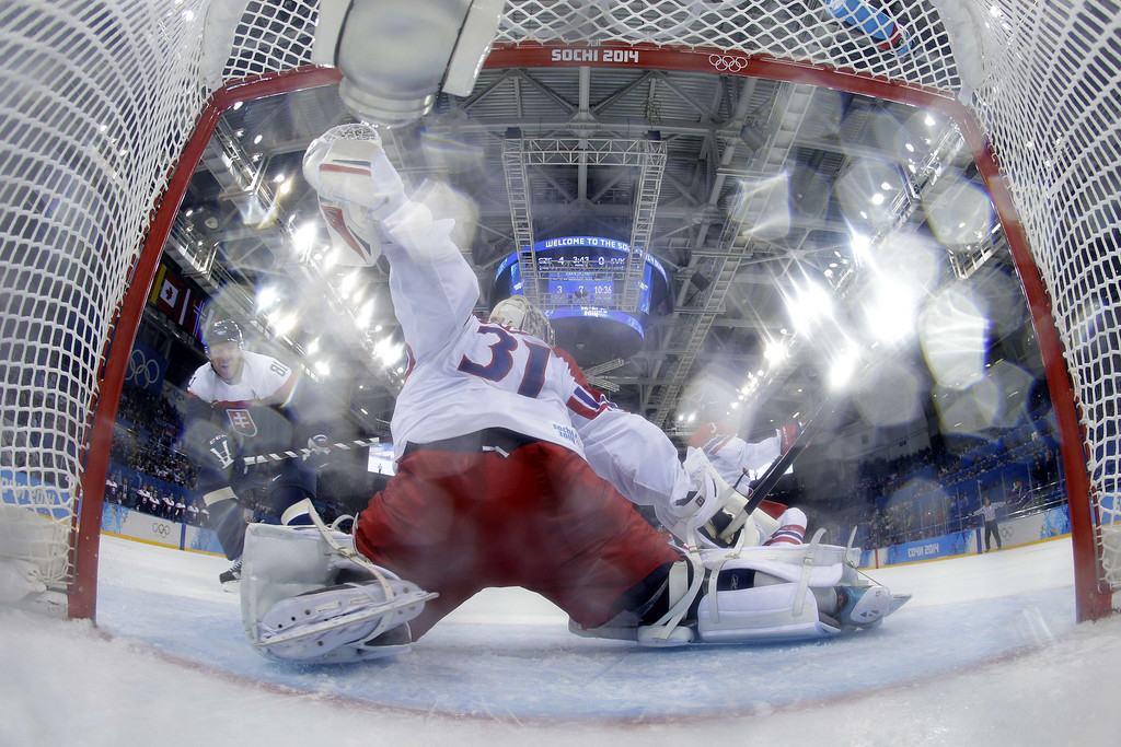 . Slovakia\'s Marian Hossa (L) scores during the Men\'s Ice Hockey Play-offs Czech Republic vs Slovakia at the Shayba Arena during the Sochi Winter Olympics on February 18, 2014.  MATT SLOCUM/AFP/Getty Images