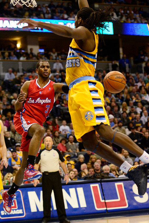 . Los Angeles Clippers point guard Chris Paul (3) passes around Denver Nuggets small forward Kenneth Faried (35) during the second half of the Nugget\'s 92-78 win at the Pepsi Center on Tuesday, January 1, 2013. AAron Ontiveroz, The Denver Post