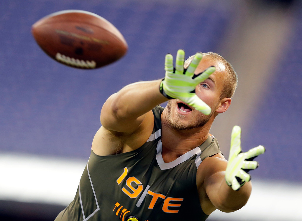 . Wisconsin tight end Jacob Pedersen makes a catch as he runs a drill at the NFL football scouting combine in Indianapolis, Saturday, Feb. 22, 2014. (AP Photo/Michael Conroy)