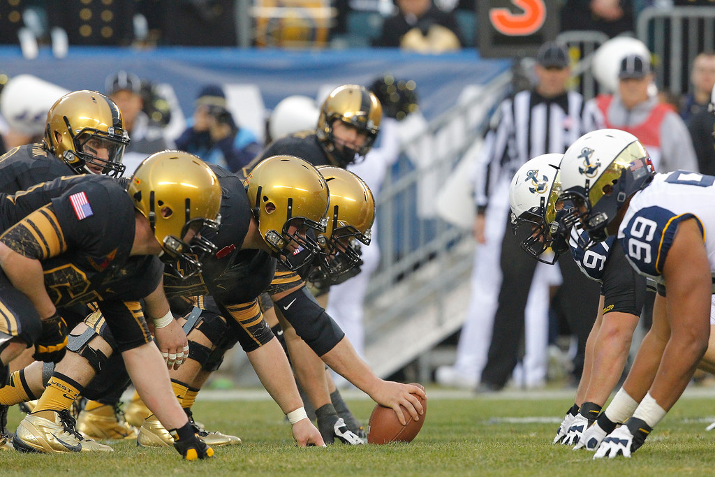 . The offensive line of the Army Black Knights gets set to snap the ball during a game against the Army Black Knights on December 8, 2012 at Lincoln Financial Field in Philadelphia, Pennsylvania. (Photo by Hunter Martin/Getty Images)
