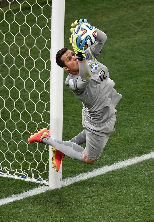 . Brazil\'s goalkeeper Julio Cesar makes a save during a Group A football match between Brazil and Croatia at the Corinthians Arena in Sao Paulo on June 12, 2014, during the 2014 FIFA World Cup.  AFP PHOTO / FRANCOIS   XAVIER MARIT/AFP/Getty Images