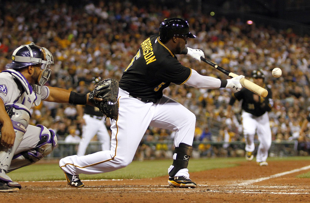 . PITTSBURGH, PA - AUGUST 03:  Josh Harrison #5 of the Pittsburgh Pirates squeezes a run in the sixth inning against the Colorado Rockies during the game on August 3, 2013 at PNC Park in Pittsburgh, Pennsylvania.  (Photo by Justin K. Aller/Getty Images)