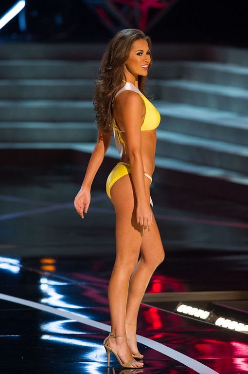 . In this photo provided by the Miss Universe Organization,  Miss Louisiana USA 2013, Kristen Girault,  competes in her swimsuit during the  2013 Miss USA Competition Preliminary Show in Las Vegas on Wednesday June 12, 2013.   She will compete for the title of Miss USA 2013 and the coveted Miss USA Diamond Nexus Crown on June 16, 2013.  (AP Photo/Miss Universe Organization, Darren Decker)