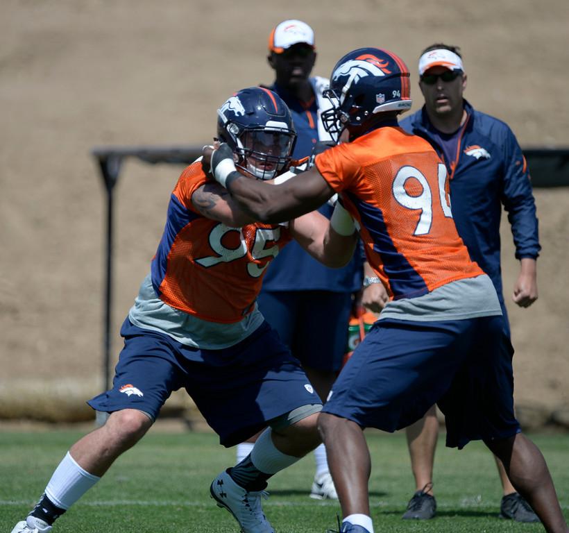 . Denver Broncos Derek Wolfe (95) runs through drills with DeMarcus Ware (94) during OTAs June 12, 2014 at Dove Valley. (Photo by John Leyba/The Denver Post)