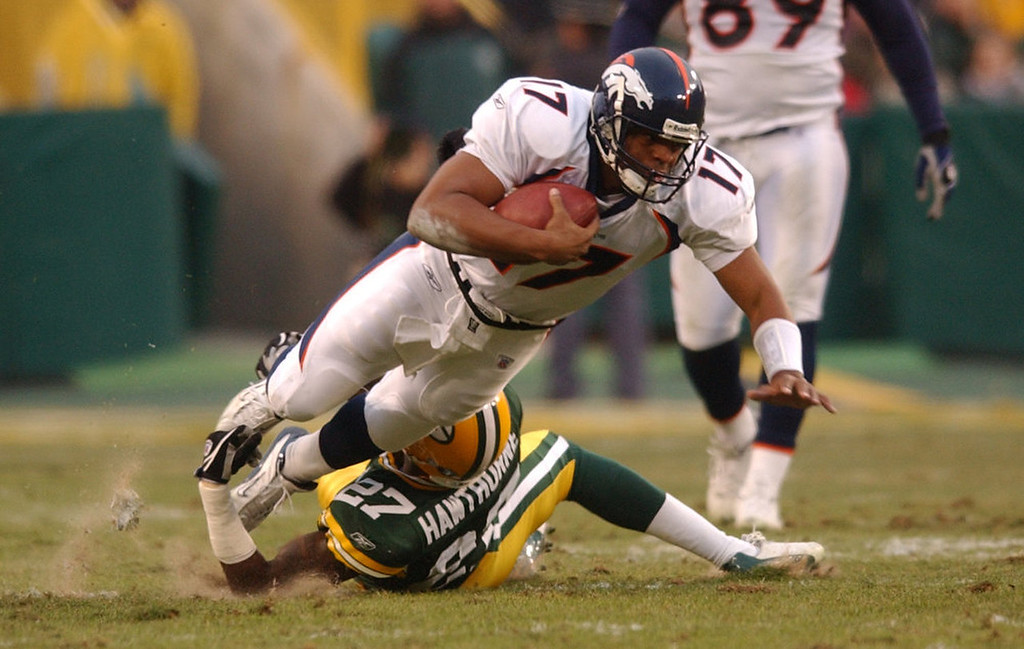 . Denver Bronco backup QB Jarrius Jackson is tackled by Green Bay Packer #27 Michael Hawthorne during a \'meaningless\' game at Lambeau Field on Sunday Dec. 28th, 2003.  The Broncos rested most of their starters including QB Jake Plummer and WR Rod Smith since they had already clinched a playoff spot  and went on to lose their playoff game to the Indianapolis Colts. (THE DENVER POST PHOTO BY HYOUNG CHANG)