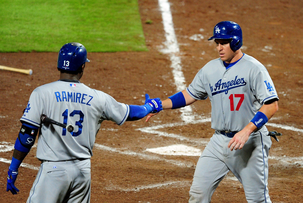 . ATLANTA, GA - OCTOBER 03: A.J. Ellis #17 of the Los Angeles Dodgers celebrates a run with teammate Hanley Ramirez #13 against the Atlanta Braves  during Game One of the National League Division Series at Turner Field on October 3, 2013 in Atlanta, Georgia.  (Photo by Scott Cunningham/Getty Images)