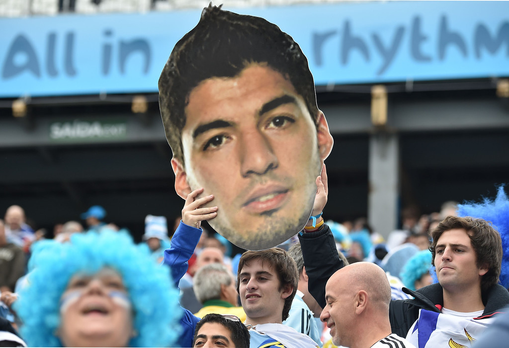 . Uruguayan fans hold a giant board depecting Uruguay\'s forward Luis Suarez before the start of a Group D football match between Uruguay and England at the Corinthians Arena in Sao Paulo during the 2014 FIFA World Cup on June 19, 2014.  LUIS ACOSTA/AFP/Getty Images