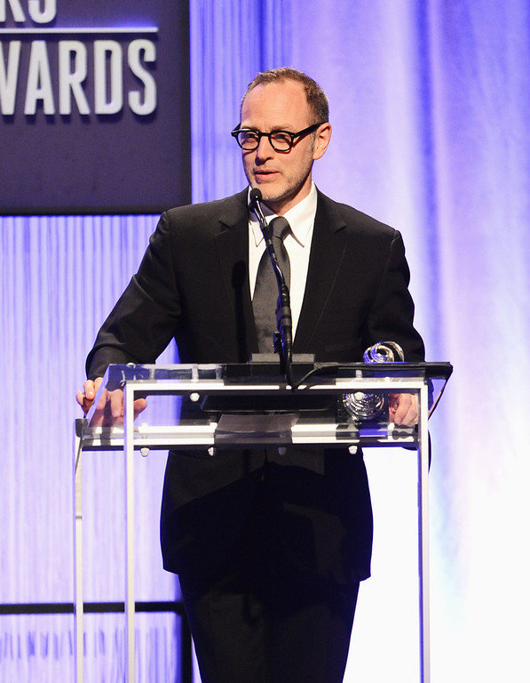 . Presenter Tom Broecker onstage during the 15th Annual Costume Designers Guild Awards with presenting sponsor Lacoste at The Beverly Hilton Hotel on February 19, 2013 in Beverly Hills, California.  (Photo by Jason Merritt/Getty Images for CDG)