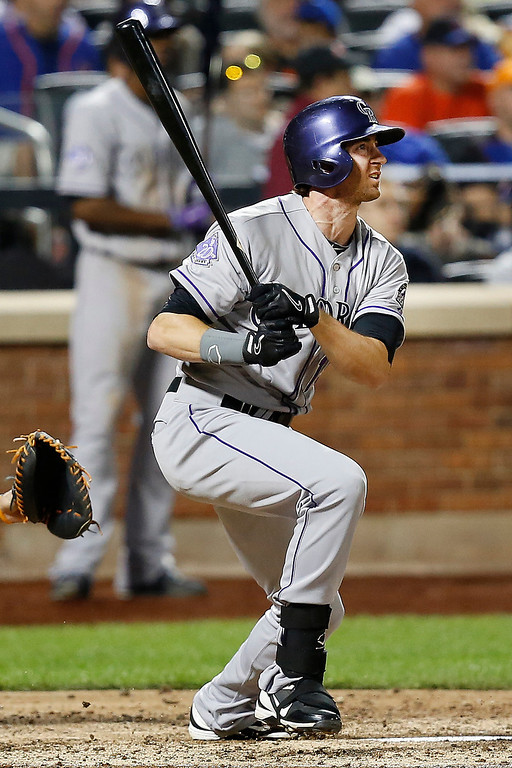 . Colorado Rockies right fielder Charlie Blackmon watches his solo home run in the sixth inning of a baseball game against the New York Mets at Citi Field, Tuesday, Aug. 6, 2013, in New York. (AP Photo/John Minchillo)