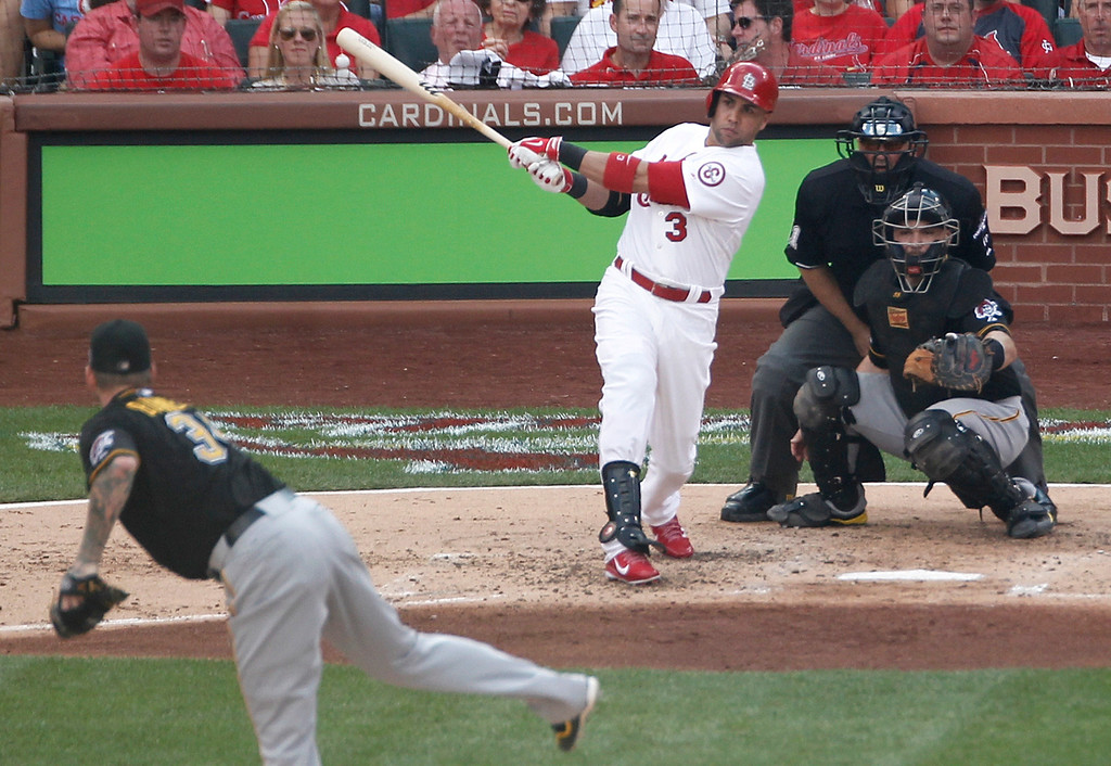 . St. Louis Cardinals\' Carlos Beltran (3) watches his three-run home run off of Pittsburgh Pirates pitcher A.J. Burnett in the third inning of Game 1 of baseball\'s National League division series, Thursday, Oct. 3, 2013, in St. Louis. (AP Photo/Sarah Conard)